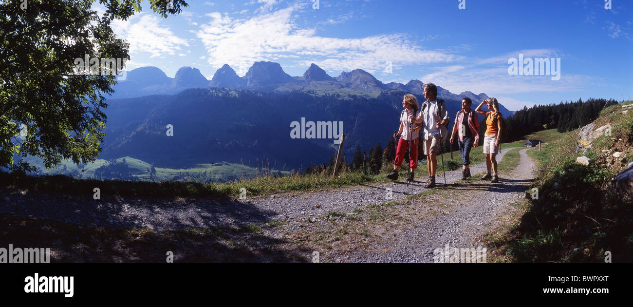 Switzerland Europe Toggenburg Alt St.Johann Canton St.Gallen hikers hiker group four persons hiking mountain - Stock Image