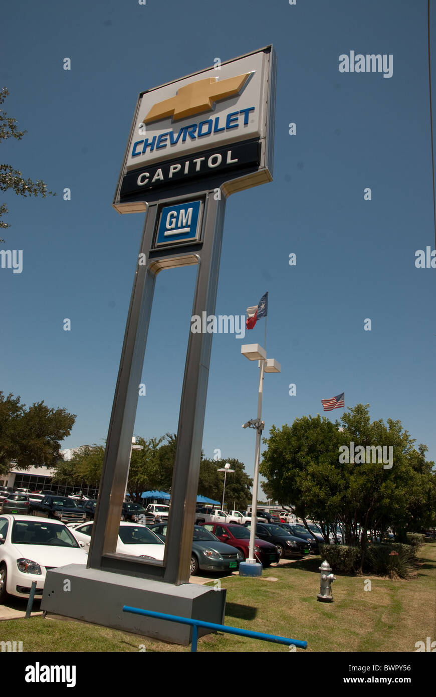 Large Capital Chevrolet sign on standards shows Chevy and General Motors logos in front of dealership in Austin, - Stock Image