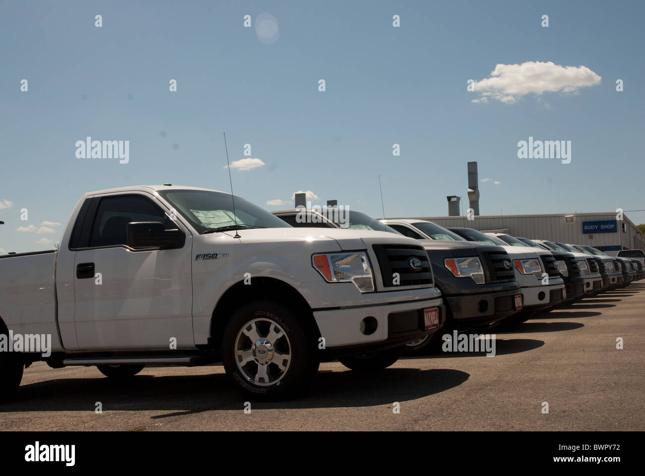 New Trucks Parked In A Row At A Ford Dealership In Austin Texas