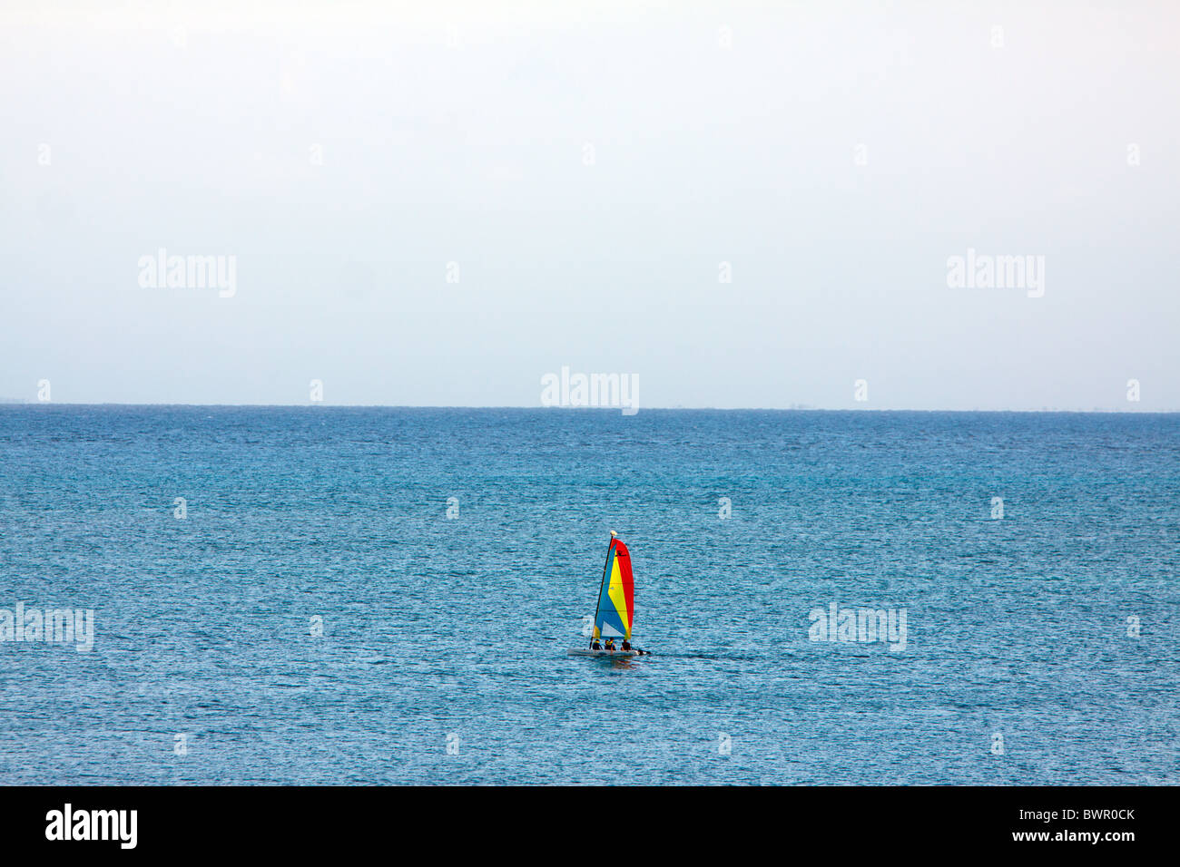 A wind sail is adrift on the ocean off the coast of the Mexican Riviera Maya region. - Stock Image