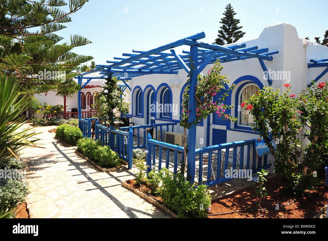 Bungalow style holiday hotel accomodation - Crete, Greece - Stock Image