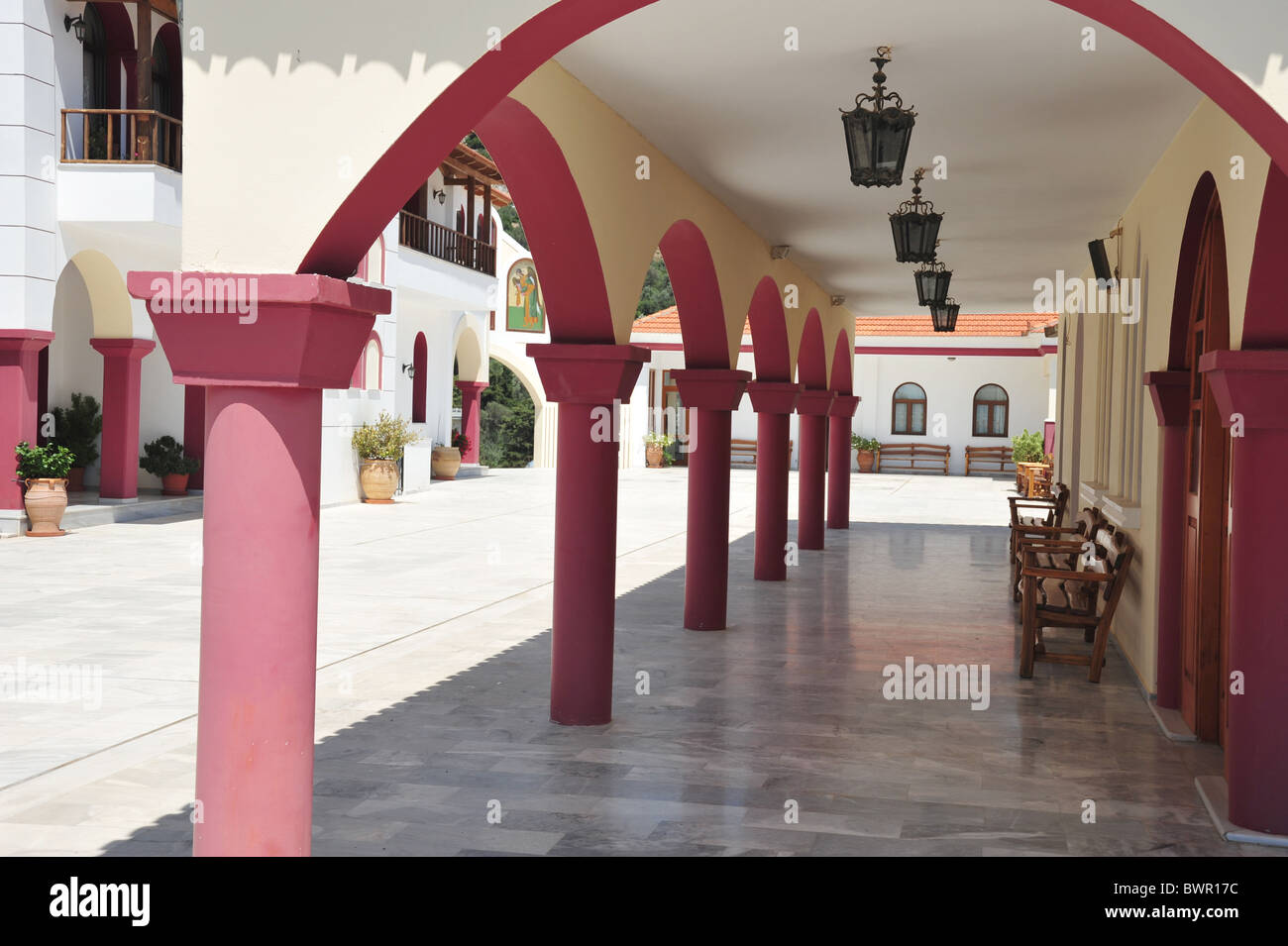 A shaded courtyard for the monks to sit and pray at the recently restored Monastry in Spilli, Crete, Greece - Stock Image