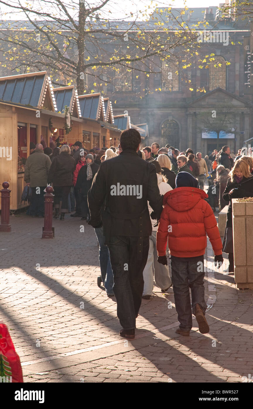 Shoppers at Manchester's Christmas Market, St Ann's Square. - Stock Image