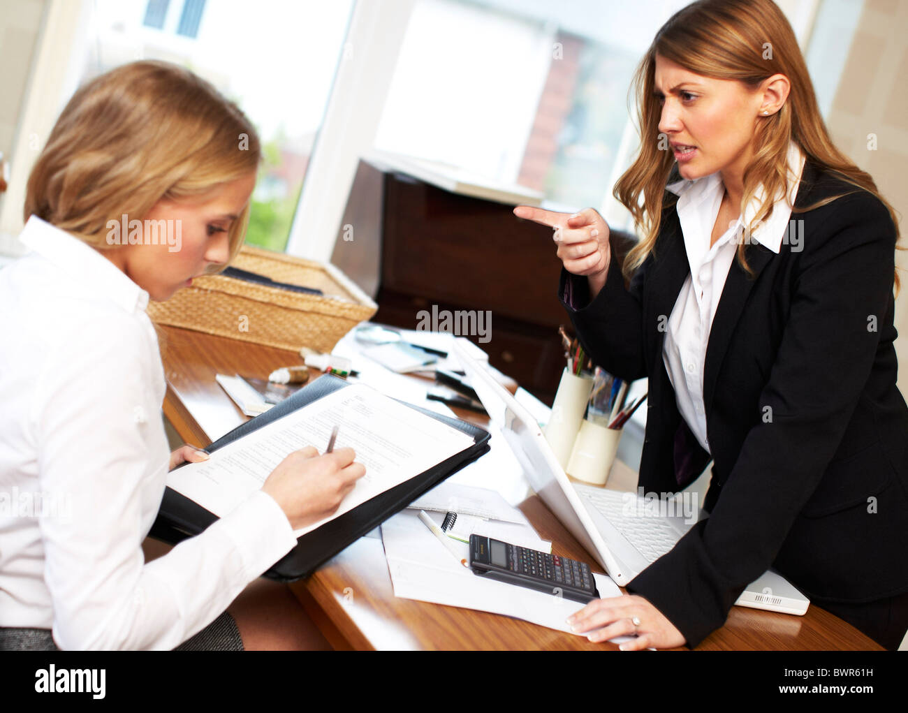 Work colleague intimidating another - Stock Image
