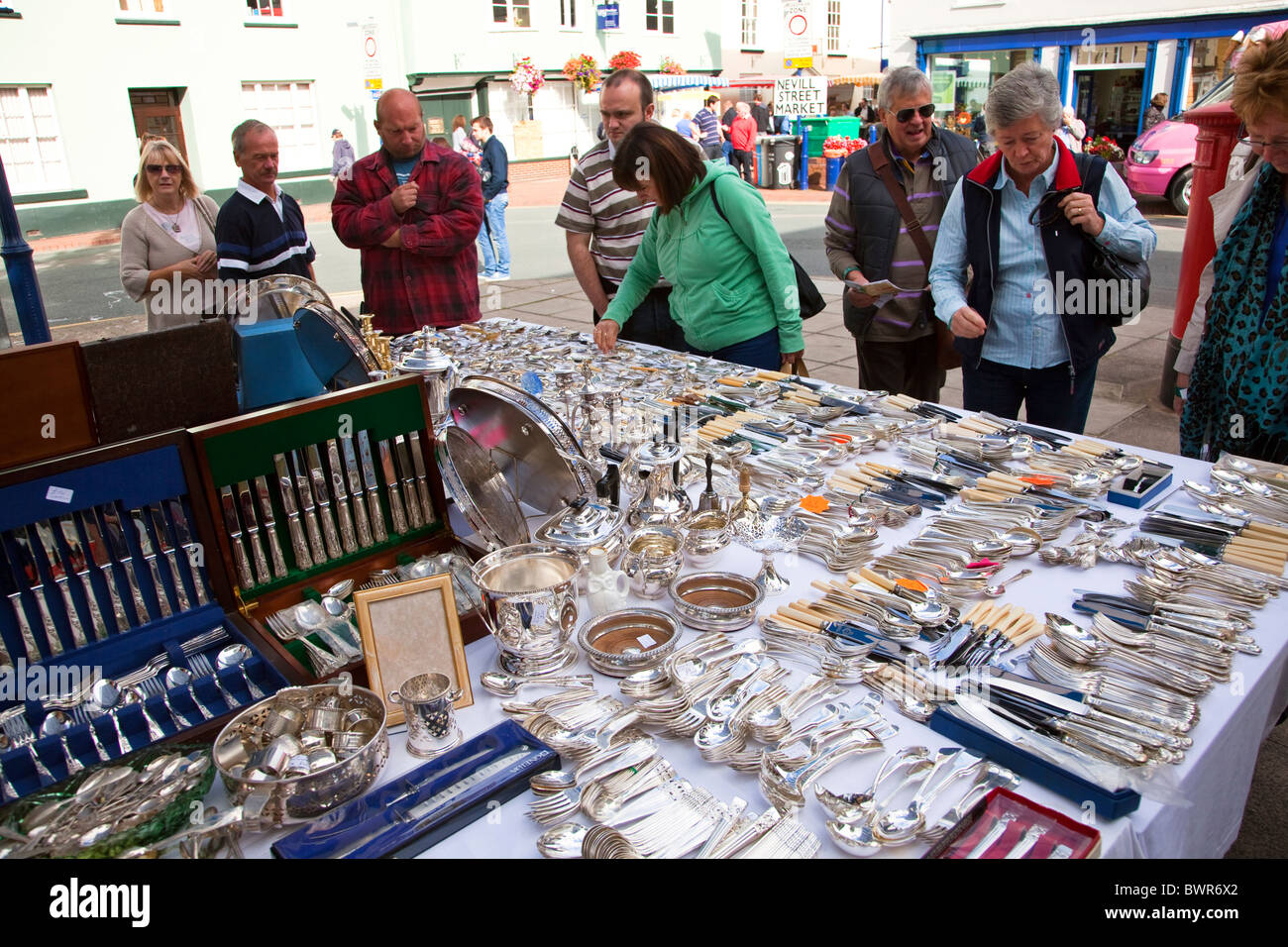 Antique silverware and cutlery on sale at street market stall Abergavenny Wales UK - Stock Image
