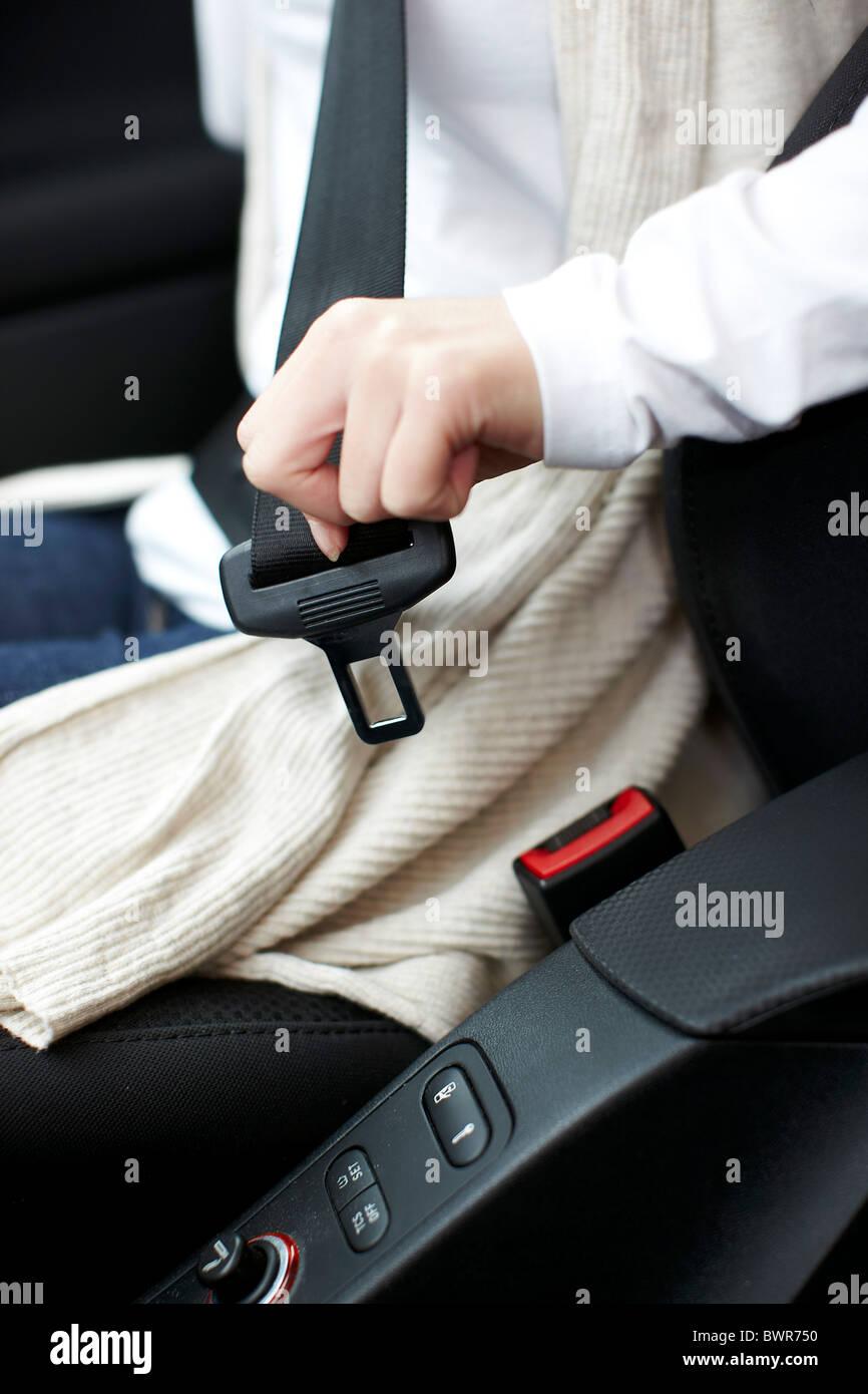 Girl wearing seatbelt Stock Photo