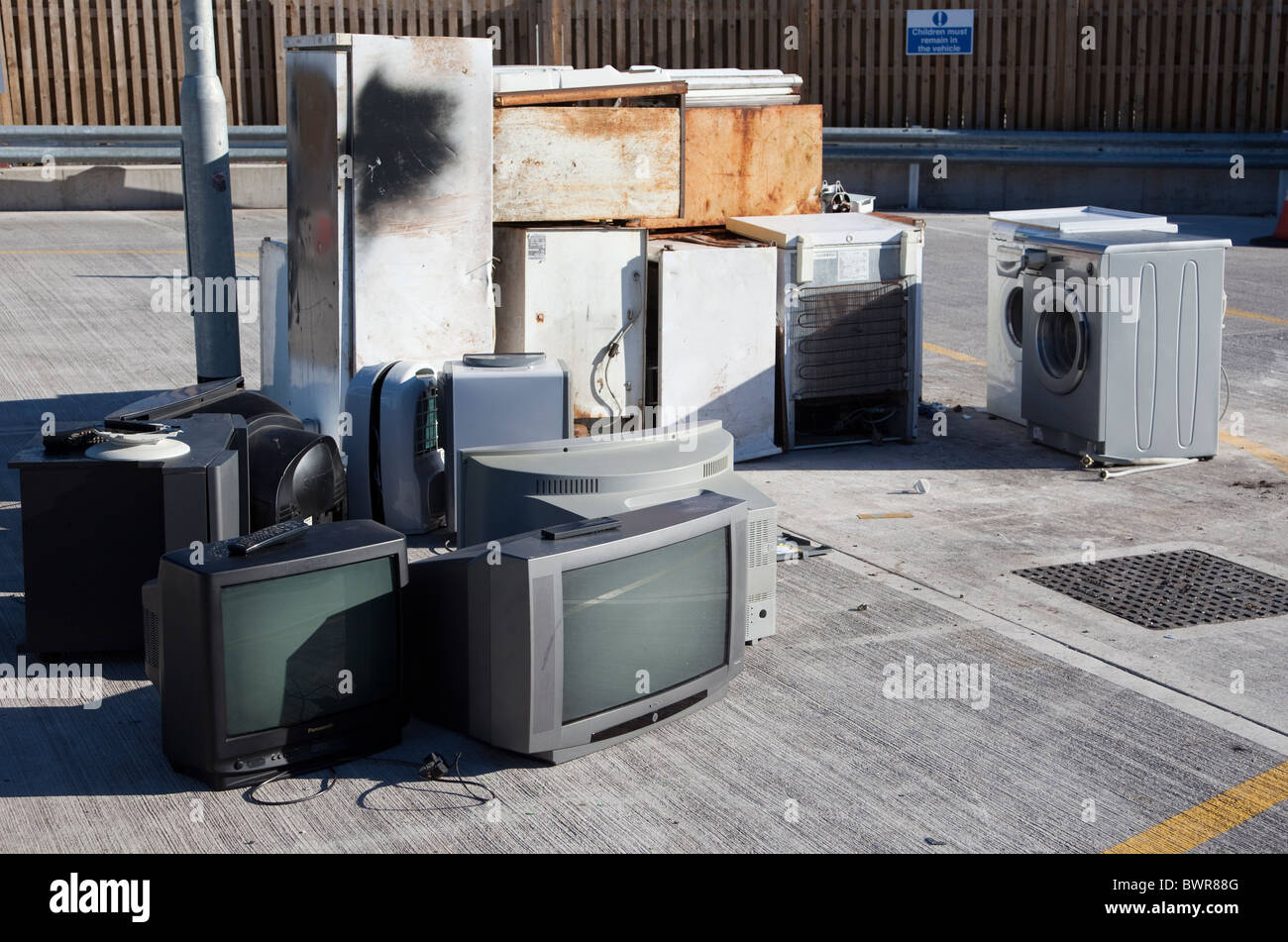 Televisions and white goods at recycling centre for disposal Wales UK - Stock Image