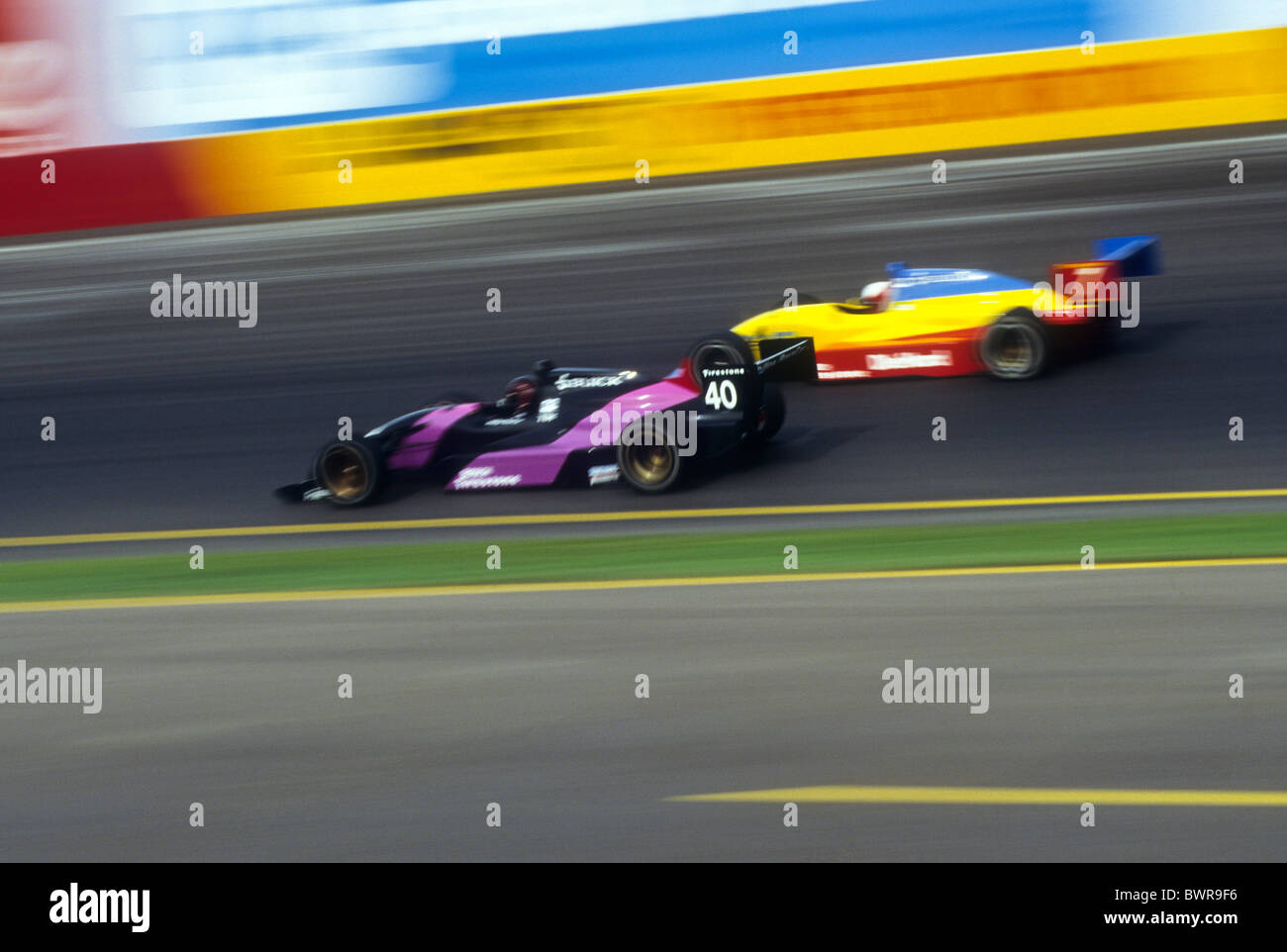 Blurred auto racing action. - Stock Image