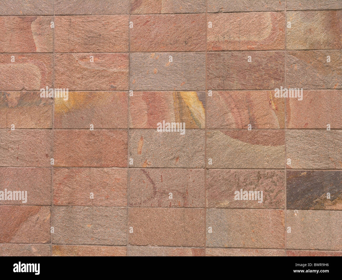 architecture wall facade stones blocks reddish structure - Stock Image