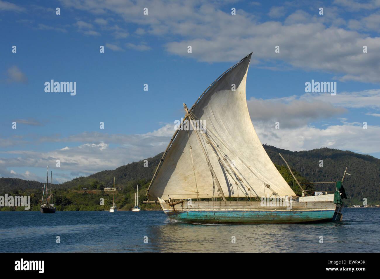 Indian Ocean Andoany city Madagascar Nosy Be island Hell Ville harbor harbor sailing boat sailboat ship coas - Stock Image