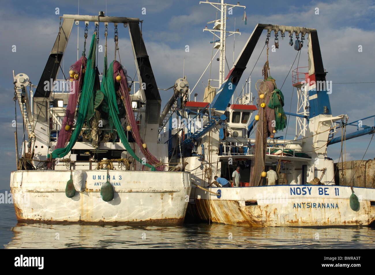 Indian Ocean Andoany city Madagascar Nosy Be island Hell Ville harbor harbor ships ship coast sea fishermen - Stock Image