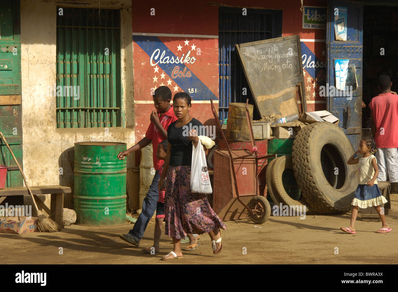 Indian Ocean Andoany city Madagascar Nosy Be island Hell Ville town street shop store locals local people - Stock Image