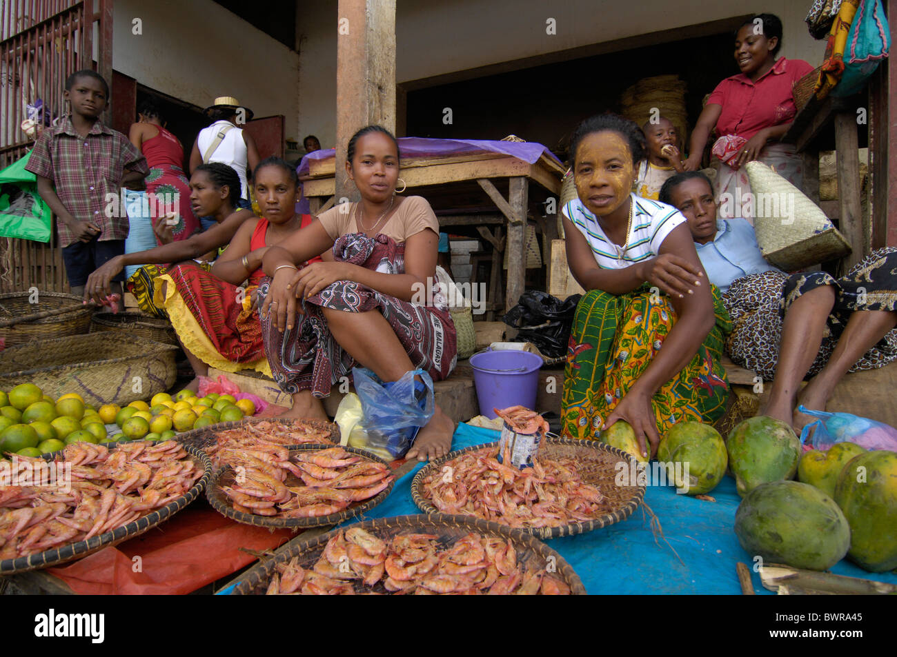 Indian Ocean Andoany city Madagascar Nosy Be island Hell Ville town street locals local people African Afric - Stock Image