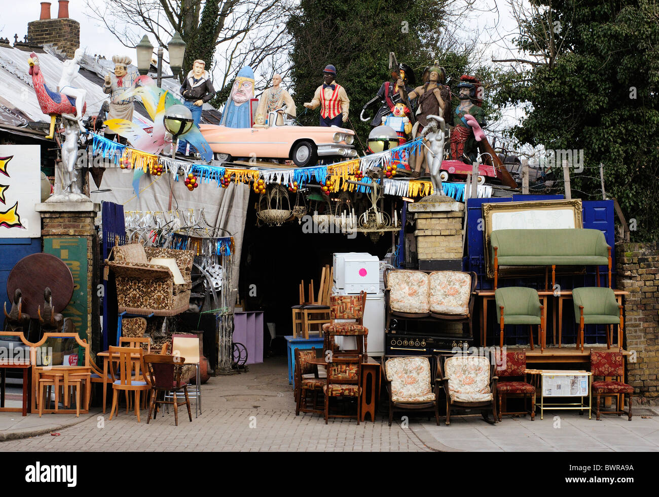 Aladdin's Cave Junk shop and reclamation yard and secondhand furniture shop, Lewisham way, London - Stock Image