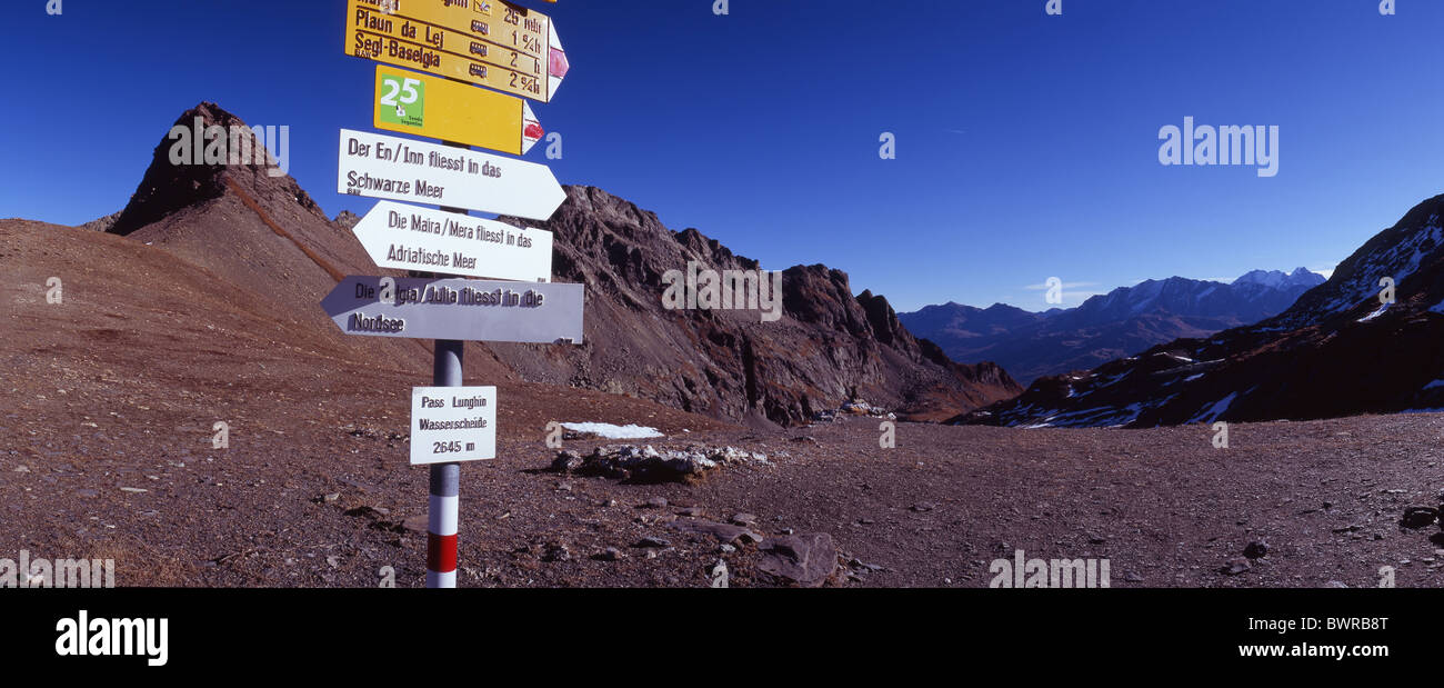 Switzerland Europe Lughin pass triple watershed trail signpost directions post geography geology hydrology - Stock Image