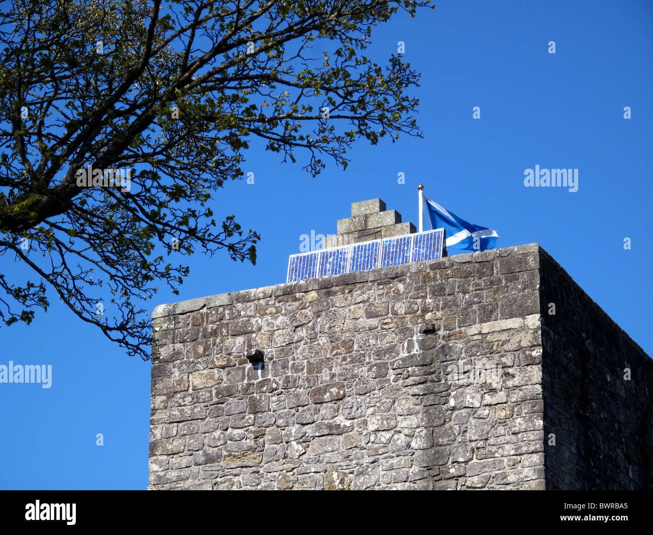 Solar panels on ancient castle roof - Stock Image
