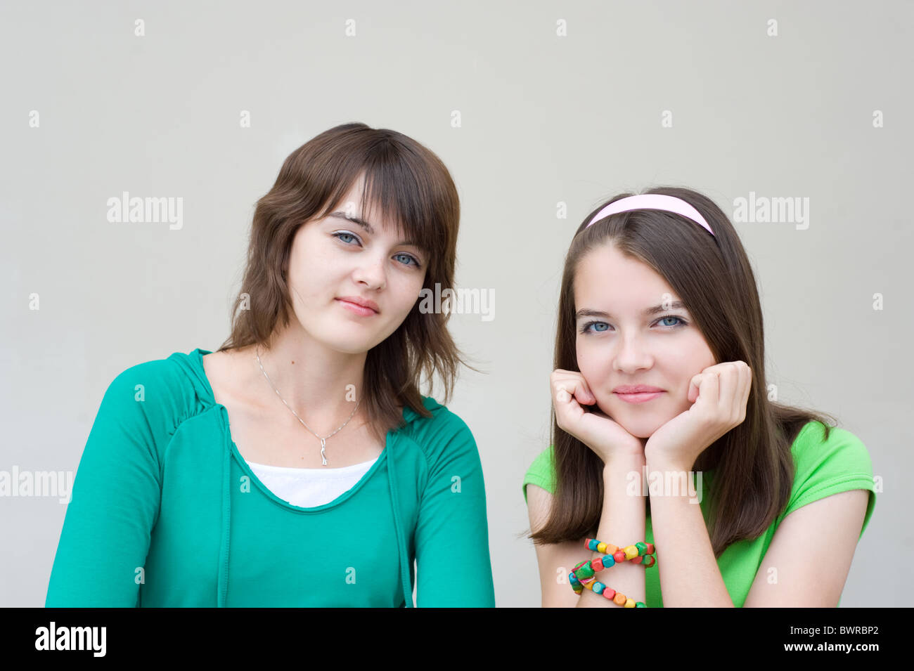 young beautiful european girls smile and look into camera - Stock Image