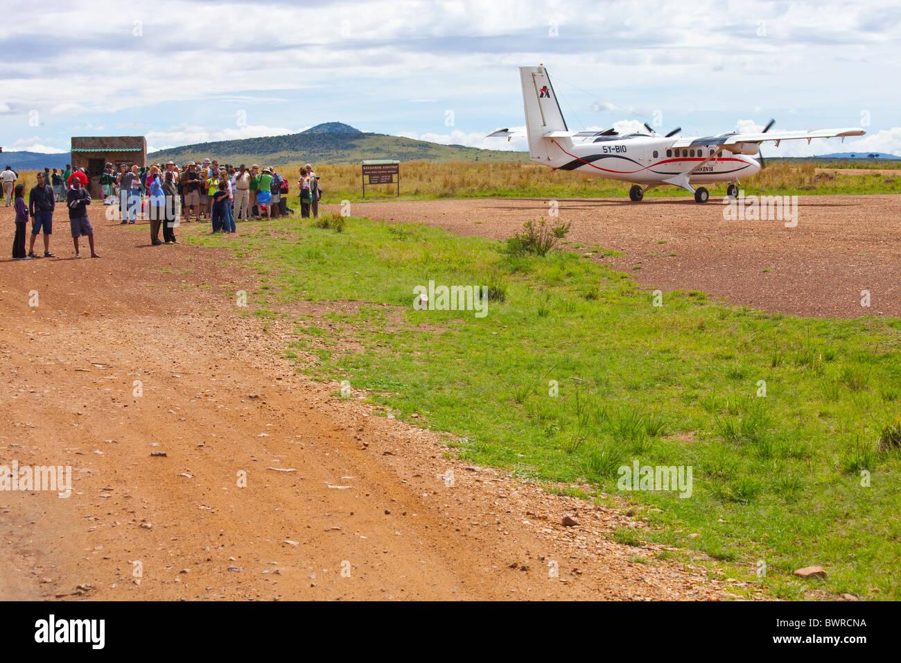 Air Kenya flight arriving in the Masai Mara, bringing tourists for safari, Kenya, East Africa - Stock Image