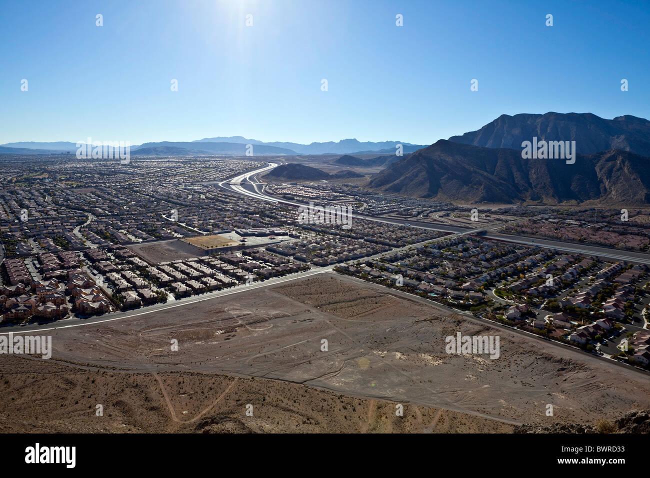 Desert suburban sprawl viewed from Lone Mountain peak towards the Summerlin neighborhood of Las Vegas Nevada. - Stock Image