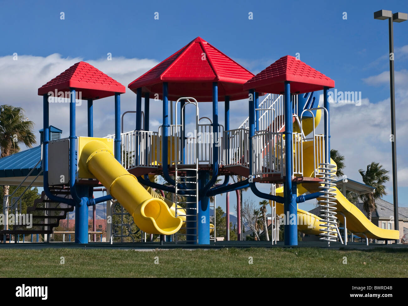 Clean, modern public park playground in the Southwestern United States. - Stock Image