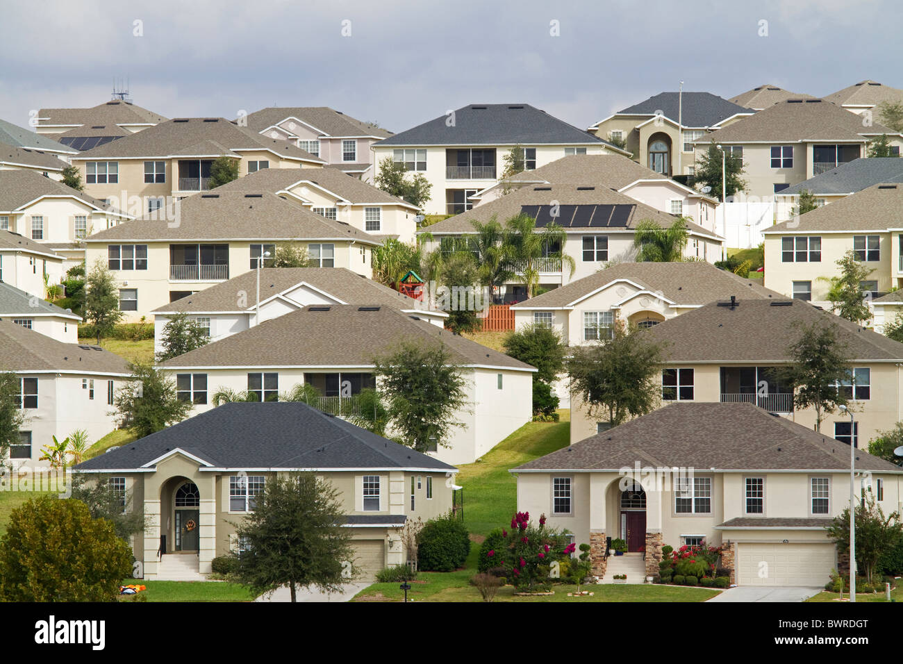 Solar panels on Florida urban neighborhood including house with solar panels and many houses. - Stock Image