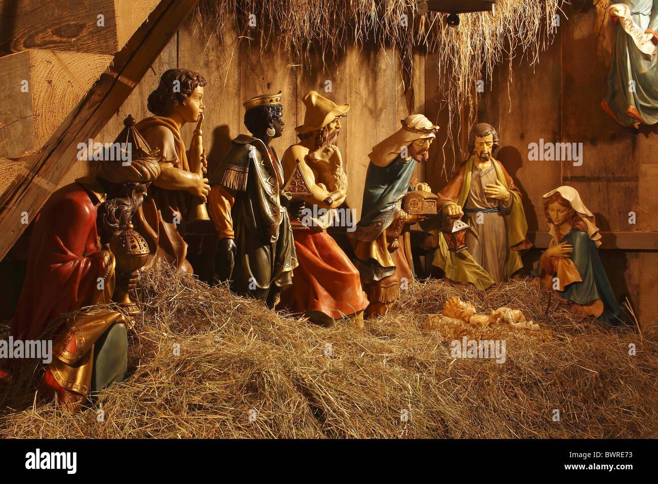christmas nativity scene religion crib manger joseph mary caspar melchior balthasar shepherds hay figures stock - Christmas Nativity Scenes