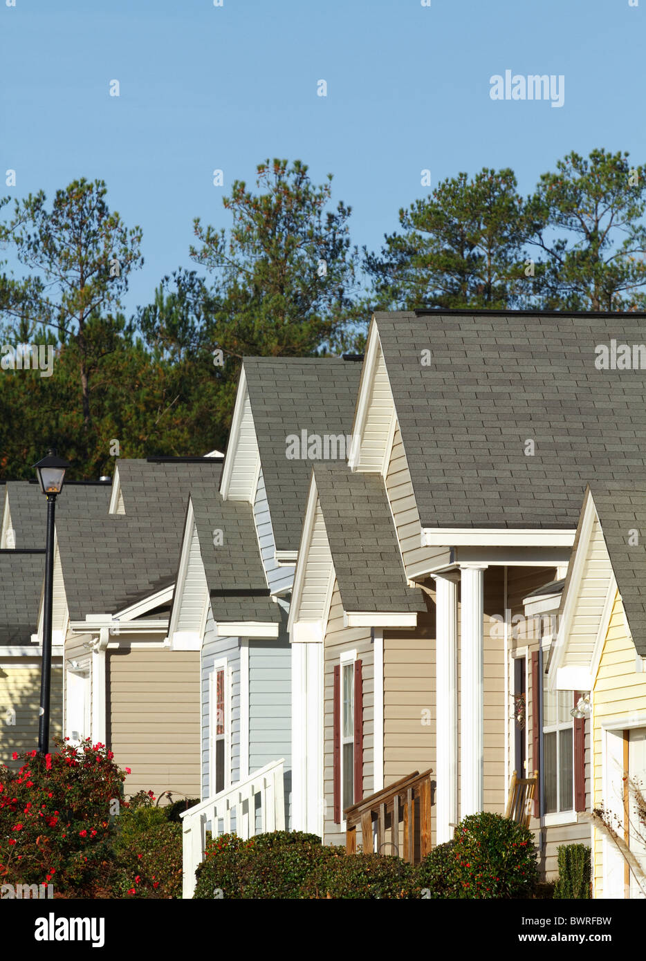 Typical modern middle-class subdivision houses in a housing development in the USA in the Fall season. Stock Photo