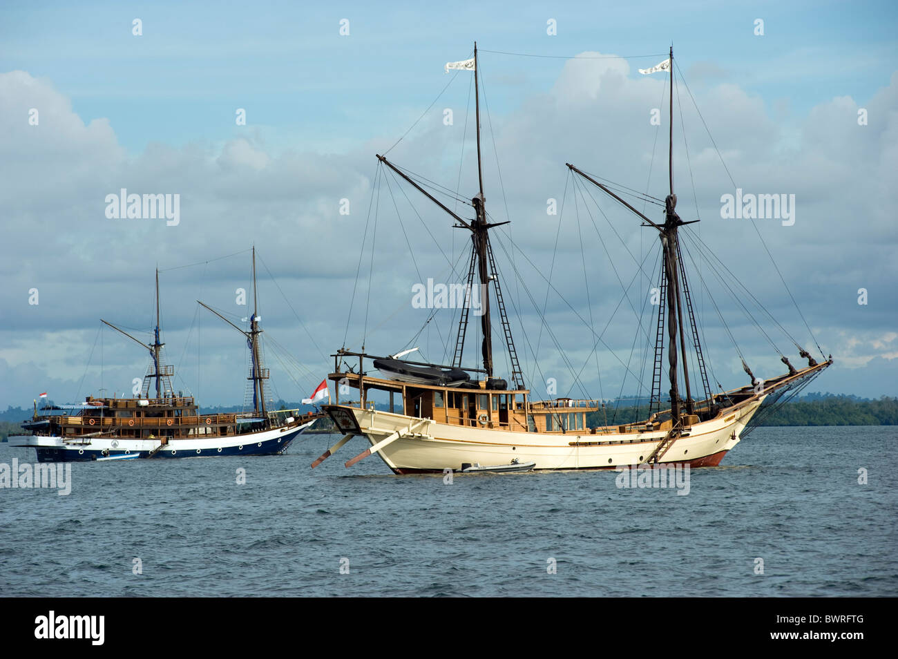 Dive charter boats in Sorong Bay, Raja Ampat Indonesia - Stock Image