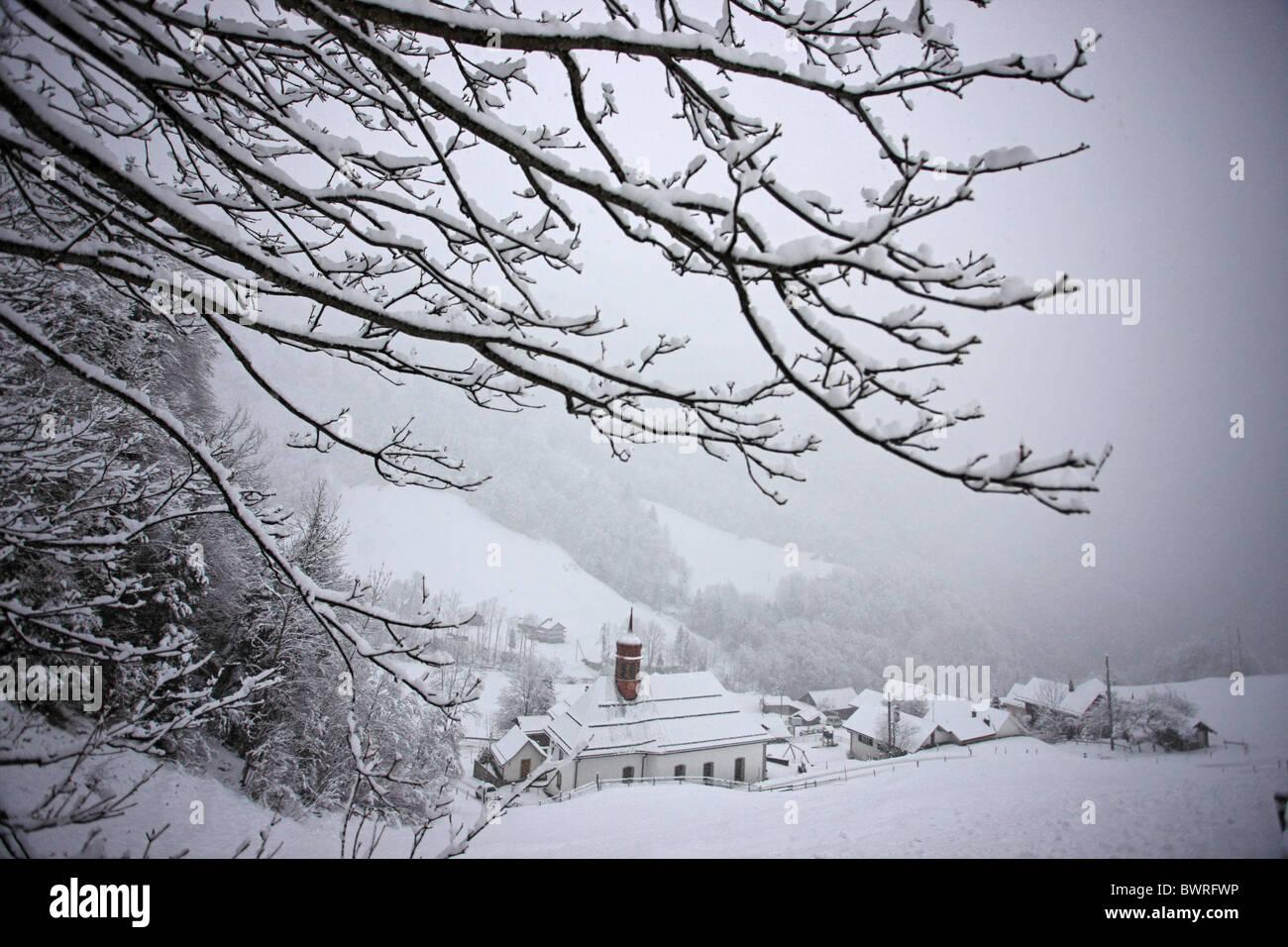 Switzerland Europe Riemenstalden Canton Schwyz Village Village of Riemenstalden Winter Snowed-in Snow Snowfal - Stock Image