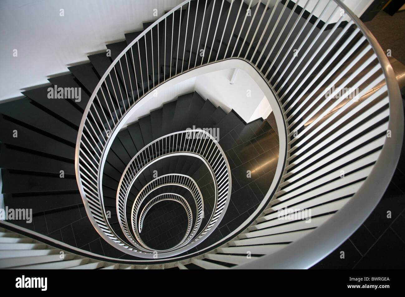 Spiral staircase stairway architecture detail white black Indoor inside building house steps floor floors - Stock Image