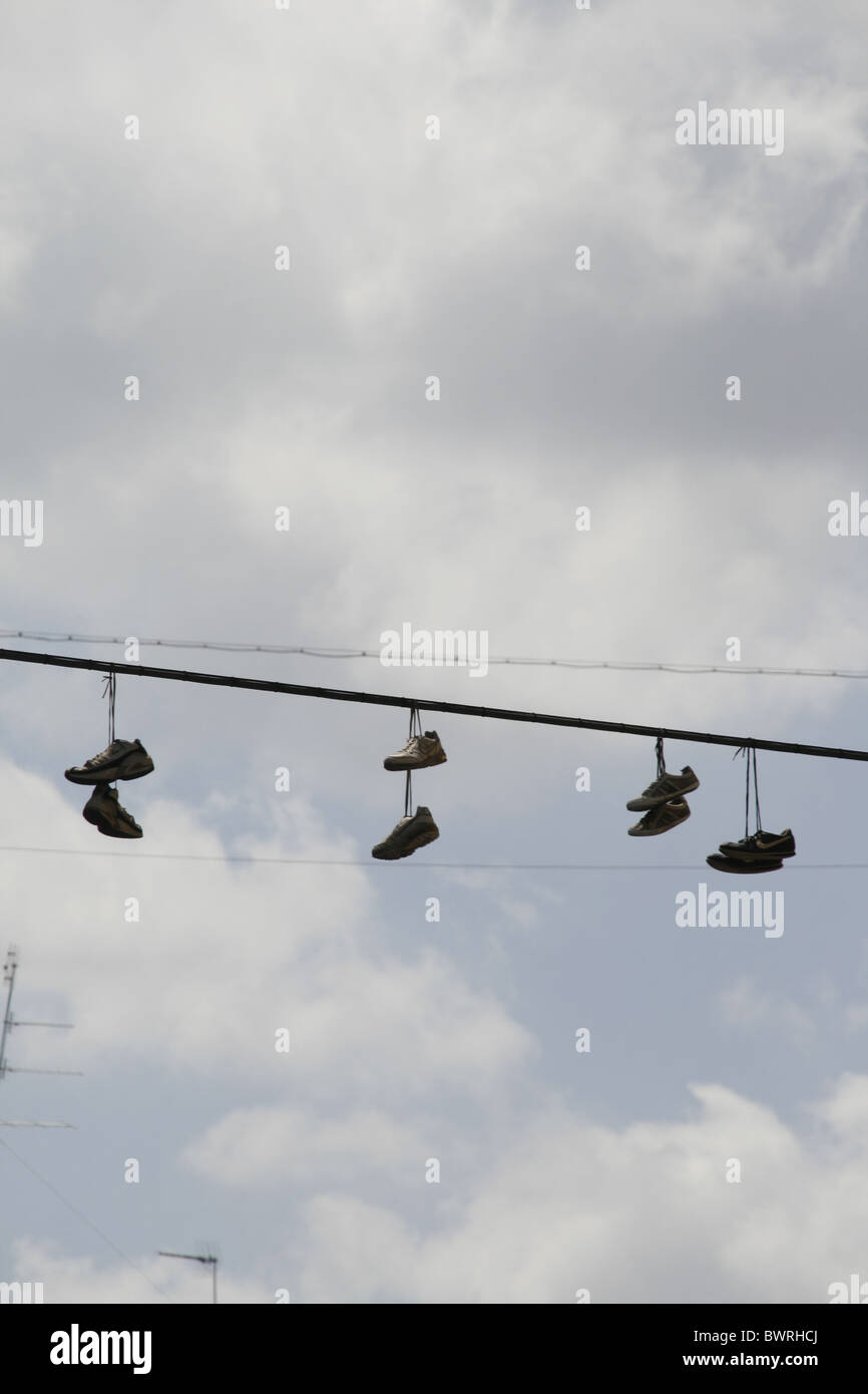 Shoes Hanging From Power Lines Stock Photos & Shoes Hanging From ...