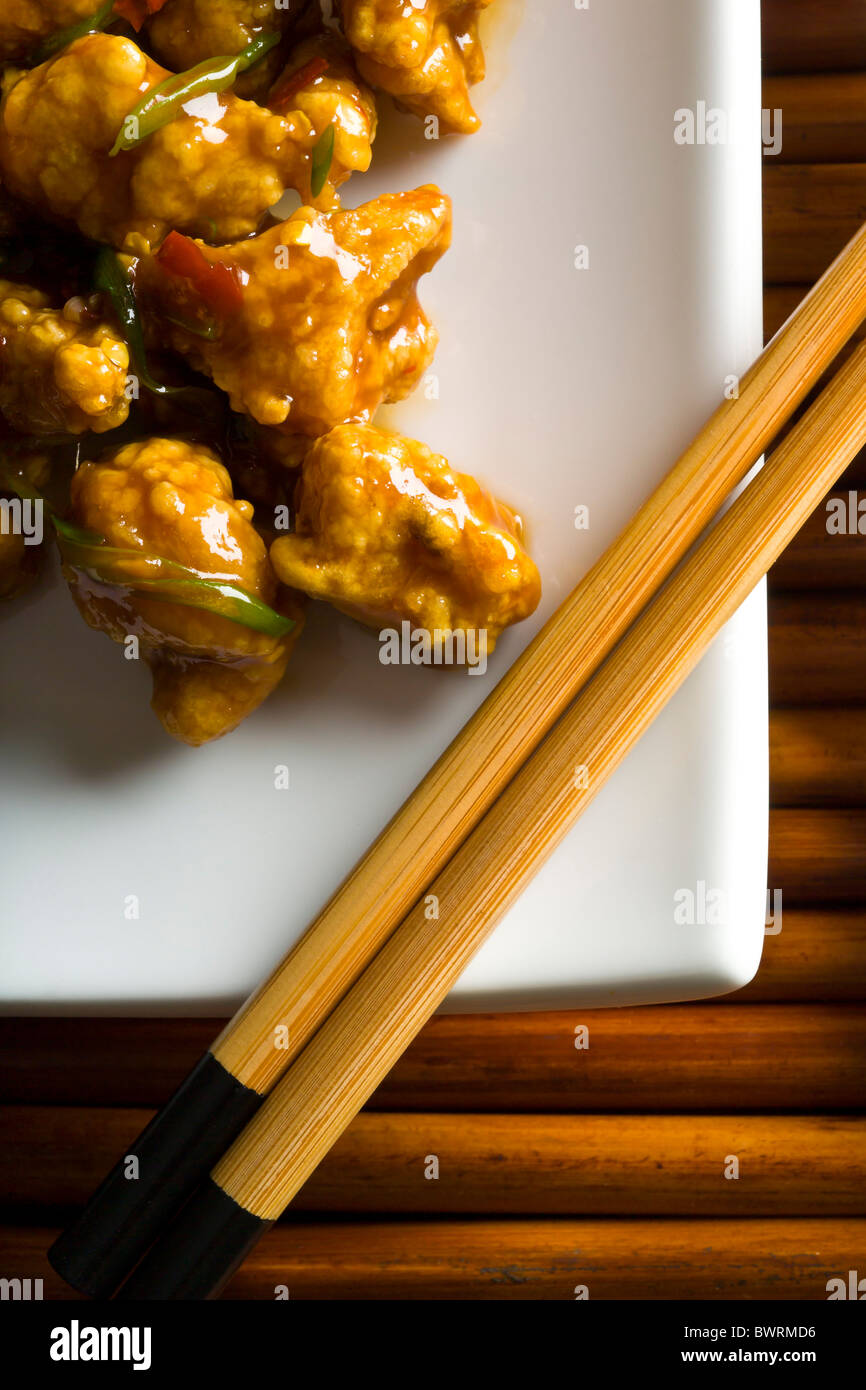 Chicken bites dipped in egg and corn starch batter, deep fried and tossed into a soy, ginger, scallion and hot pepper Stock Photo