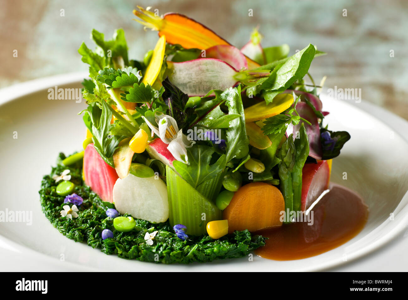 A variety of crisp and tender with crushed herbs prepared by Tony Esnault, Executive Chef of Adour at The St. Regis - Stock Image