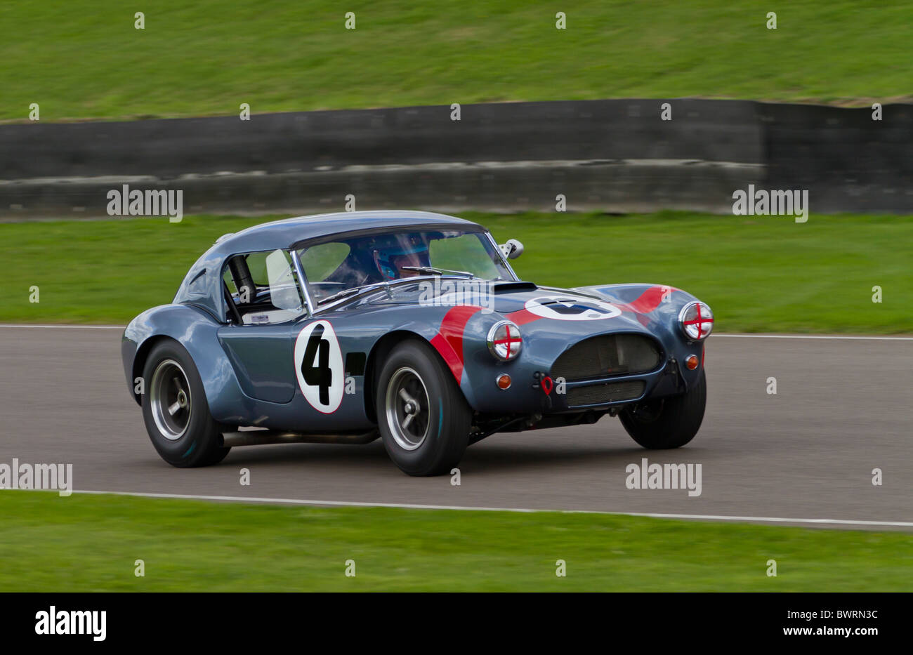 1962 AC Cobra with driver David Hart. RAC TT Celebration race. 2010 Goodwood Revival, Sussex, England, UK. - Stock Image