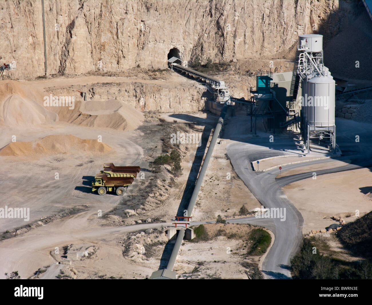 Trucks and buildings at a stone quarry, Provence, France - Stock Image