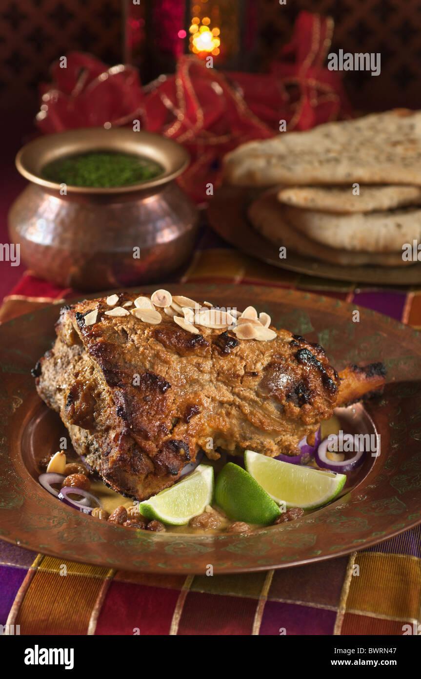 Raan Masaledar. Spiced leg of lamb. India Food - Stock Image