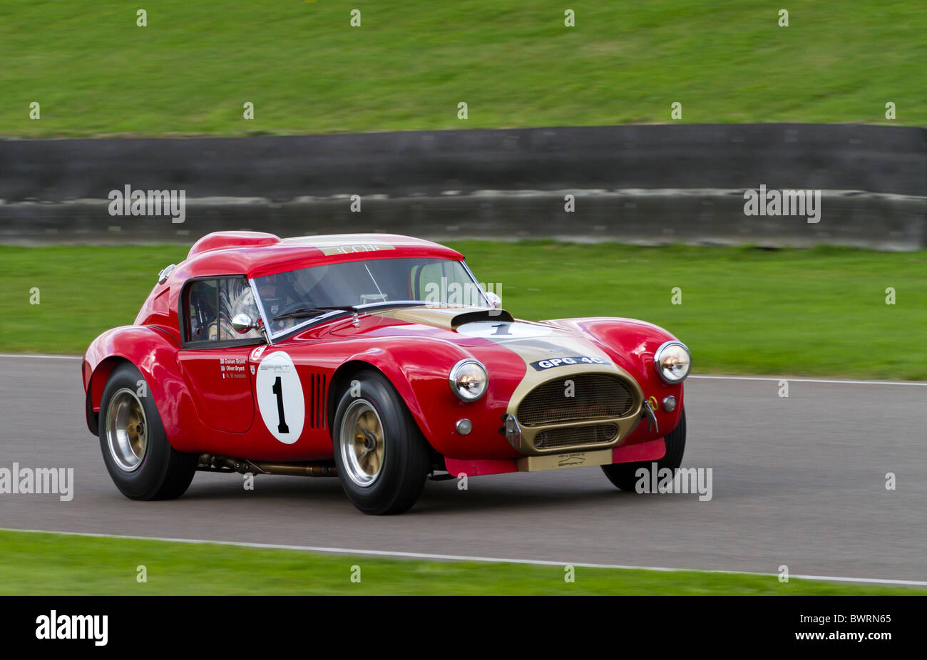 1964 AC Cobra with driver Oliver Bryant. RAC TT Celebration race. 2010 Goodwood Revival, Sussex, England, UK. - Stock Image