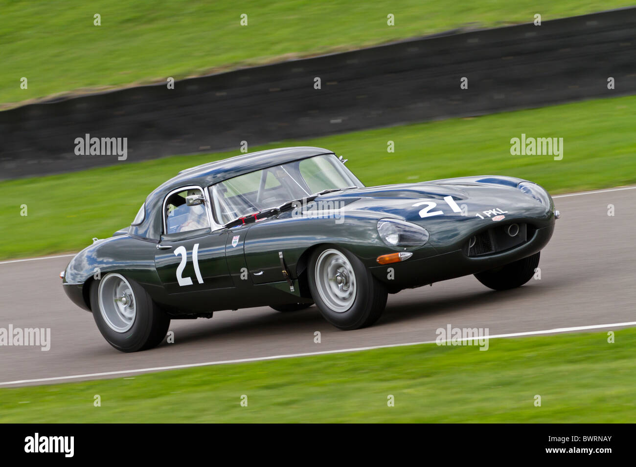 1961 Jaguar E-Type during the RAC TT Celebration race. 2010 Goodwood Revival meeting, Sussex, England, UK. - Stock Image