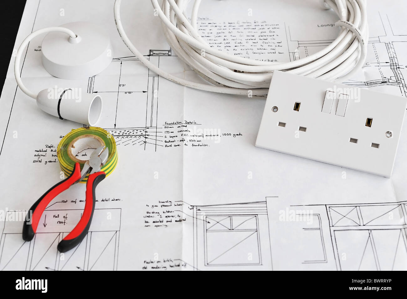 Electricity Diagram Stock Photos Images Glass On The Electronic Schematic Diagramideal Technology Background Home Extension Remodelling Blueprint Plans With Some Electrical Items Placed It Image