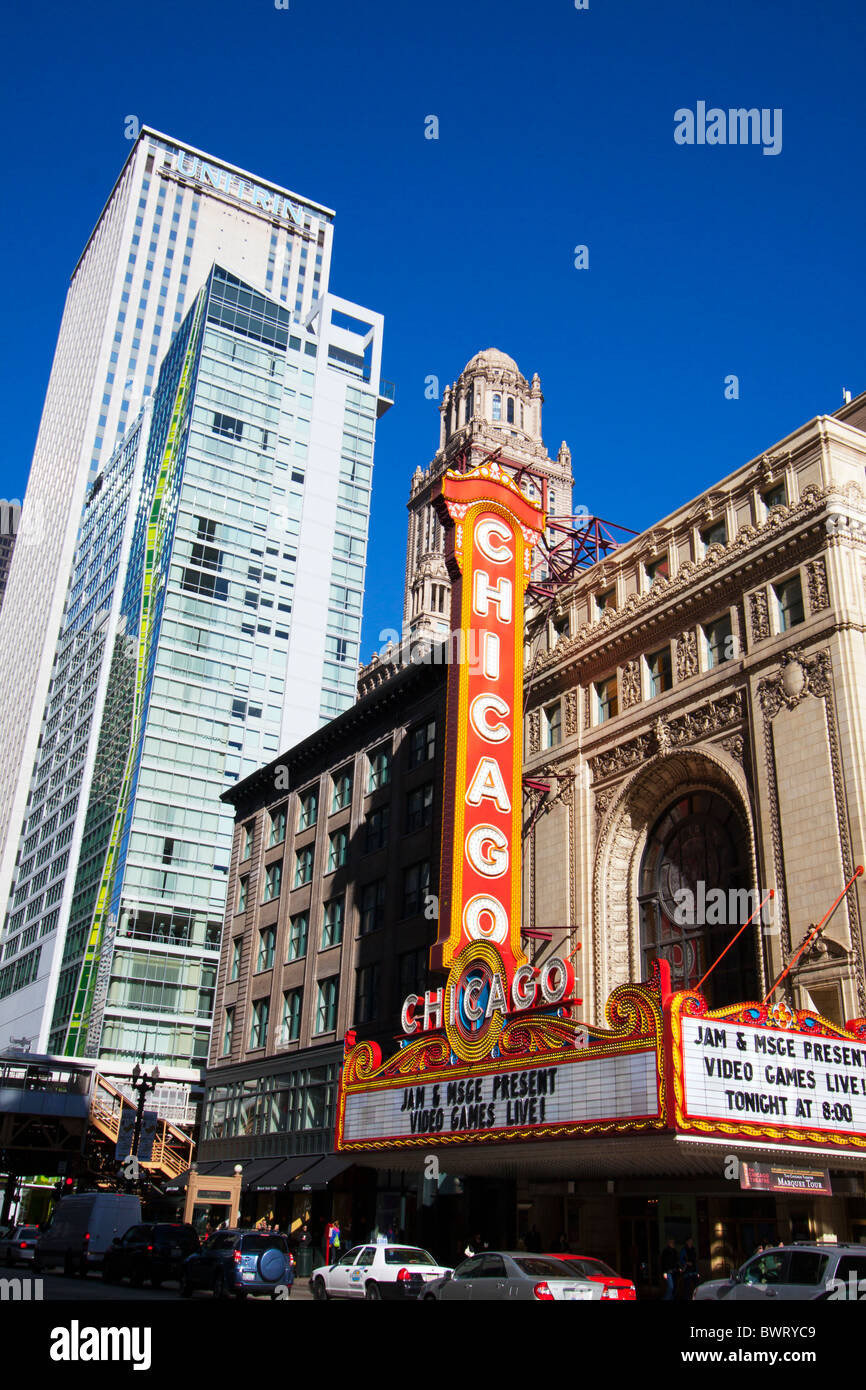 The famous Chicago Theater sign shines in late afternoon sun in Chicago's Loop. - Stock Image