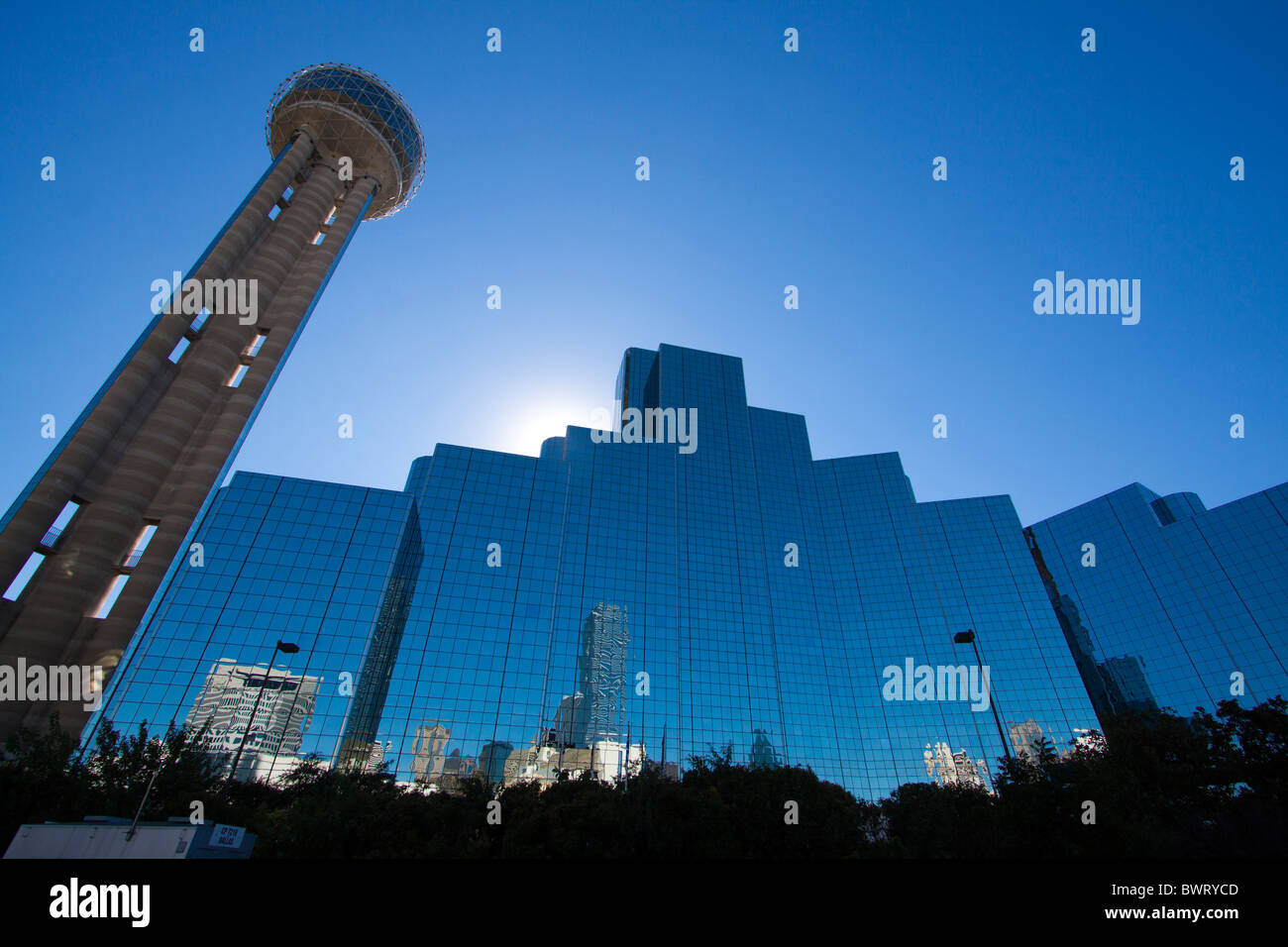 Reunion Tower in Dallas, Texas is silhouetted by the warm sunshine. - Stock Image