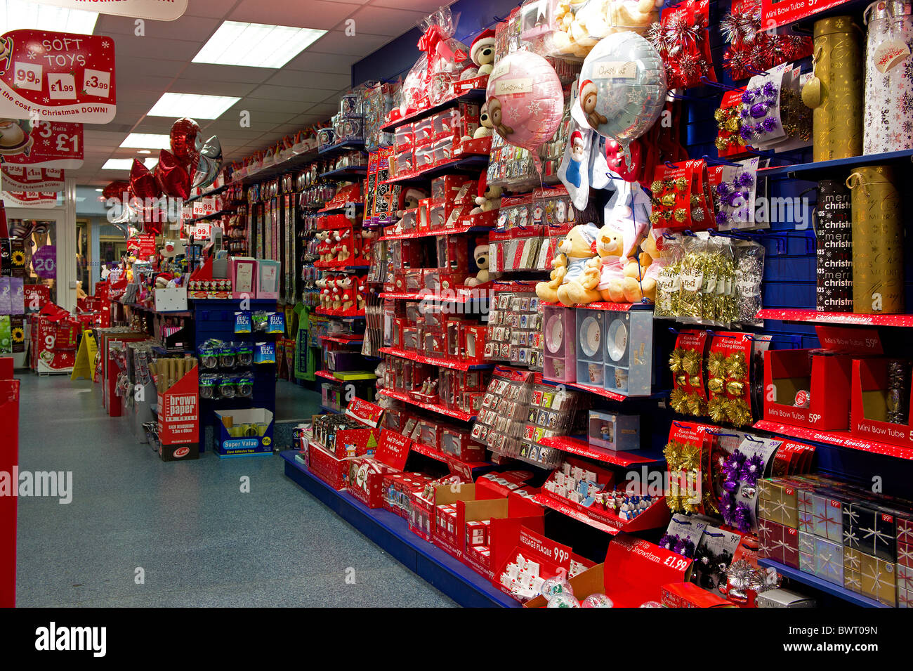 a high street shop selling christmas decorations and gifts - Stock Image