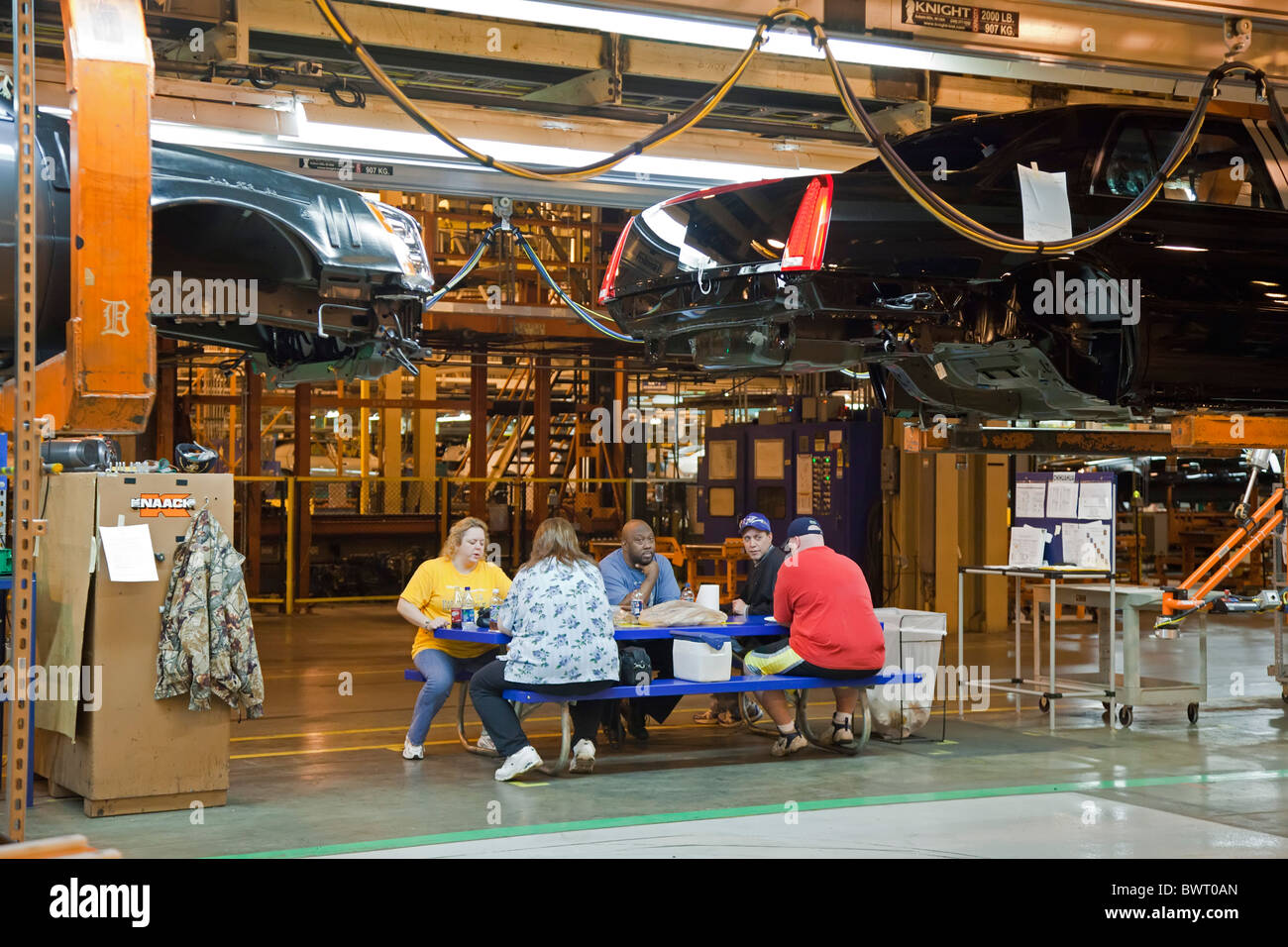 Workers Eat Lunch at Auto Assembly Plant - Stock Image