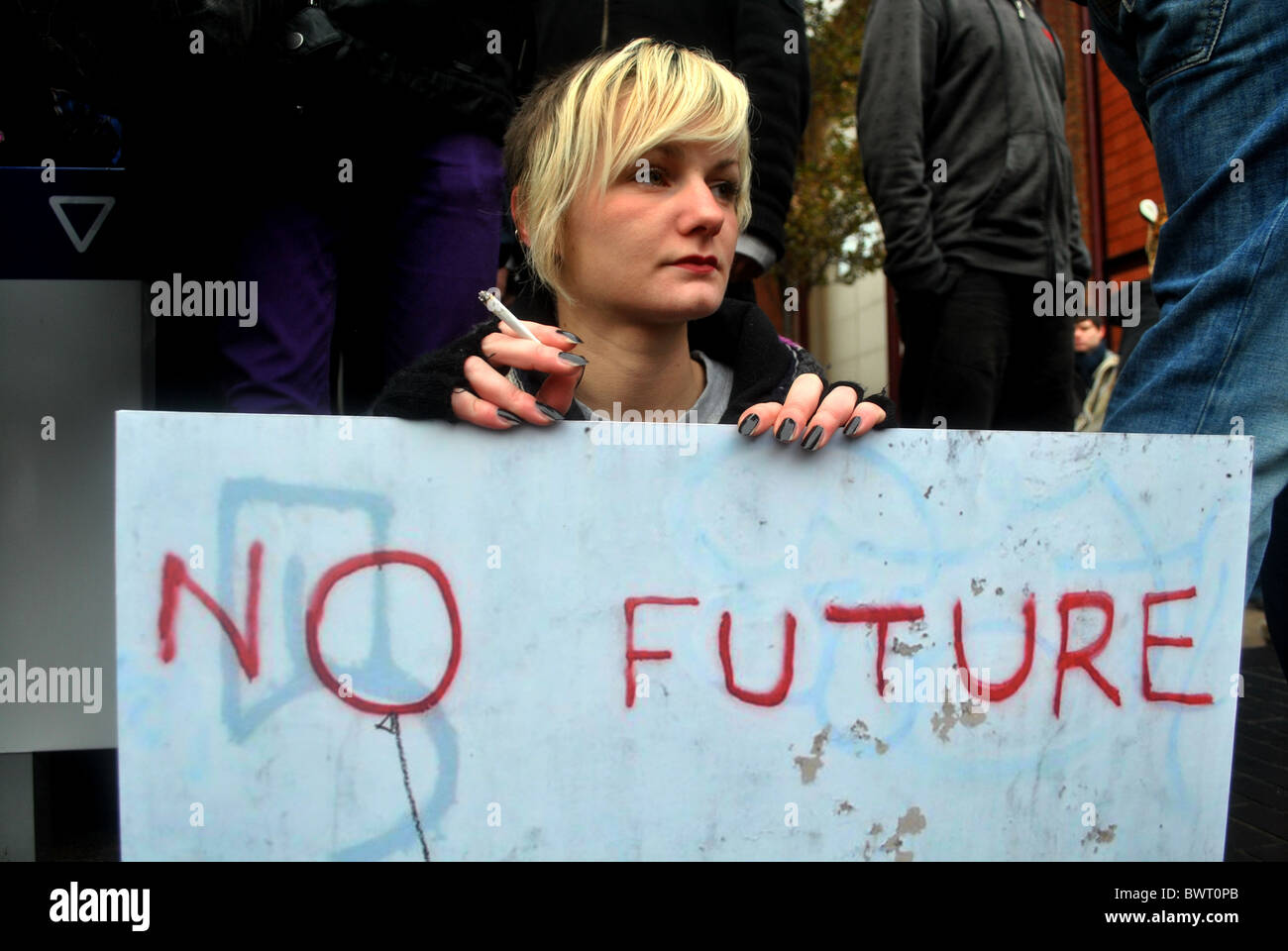 Student with placard at protest over tuition fees at the University of Bristol - Stock Image