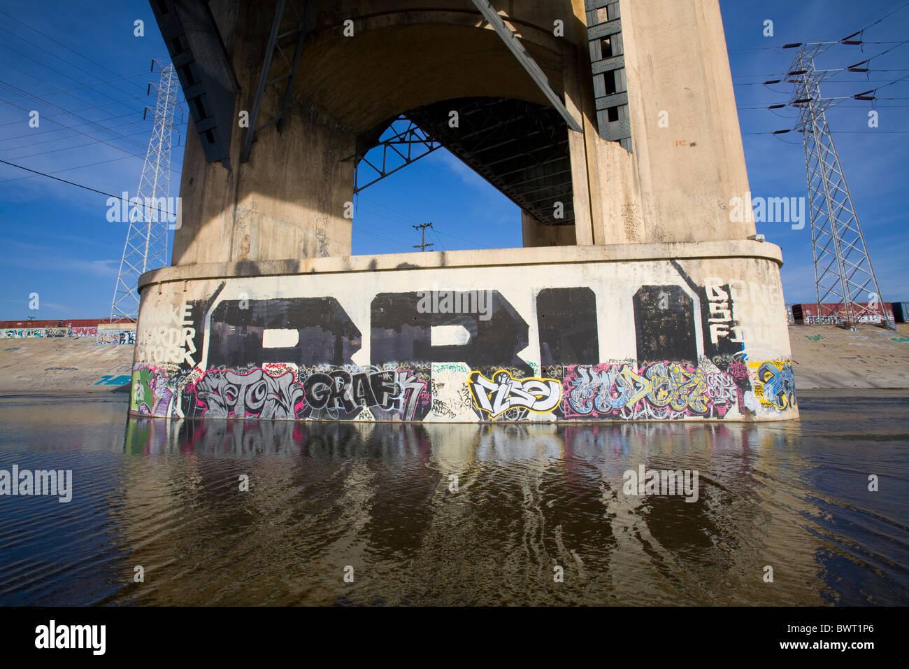 Graffiti under the 6th St Bridge, Stop on Folar's tour of the LA River, Los Angeles, California, USA - Stock Image