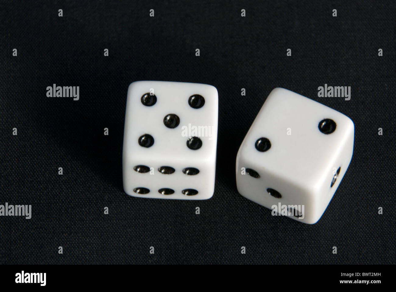 Dice that show a 7 for craps or other dice game, concept of gambling, addiction, winning, financial gain or financial - Stock Image