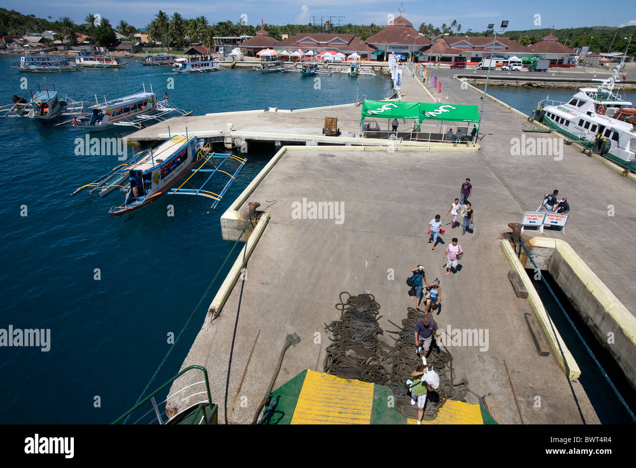 Filipinos board a ferry boat at the Port of Caticlan in Aklan, Philippines. - Stock Image