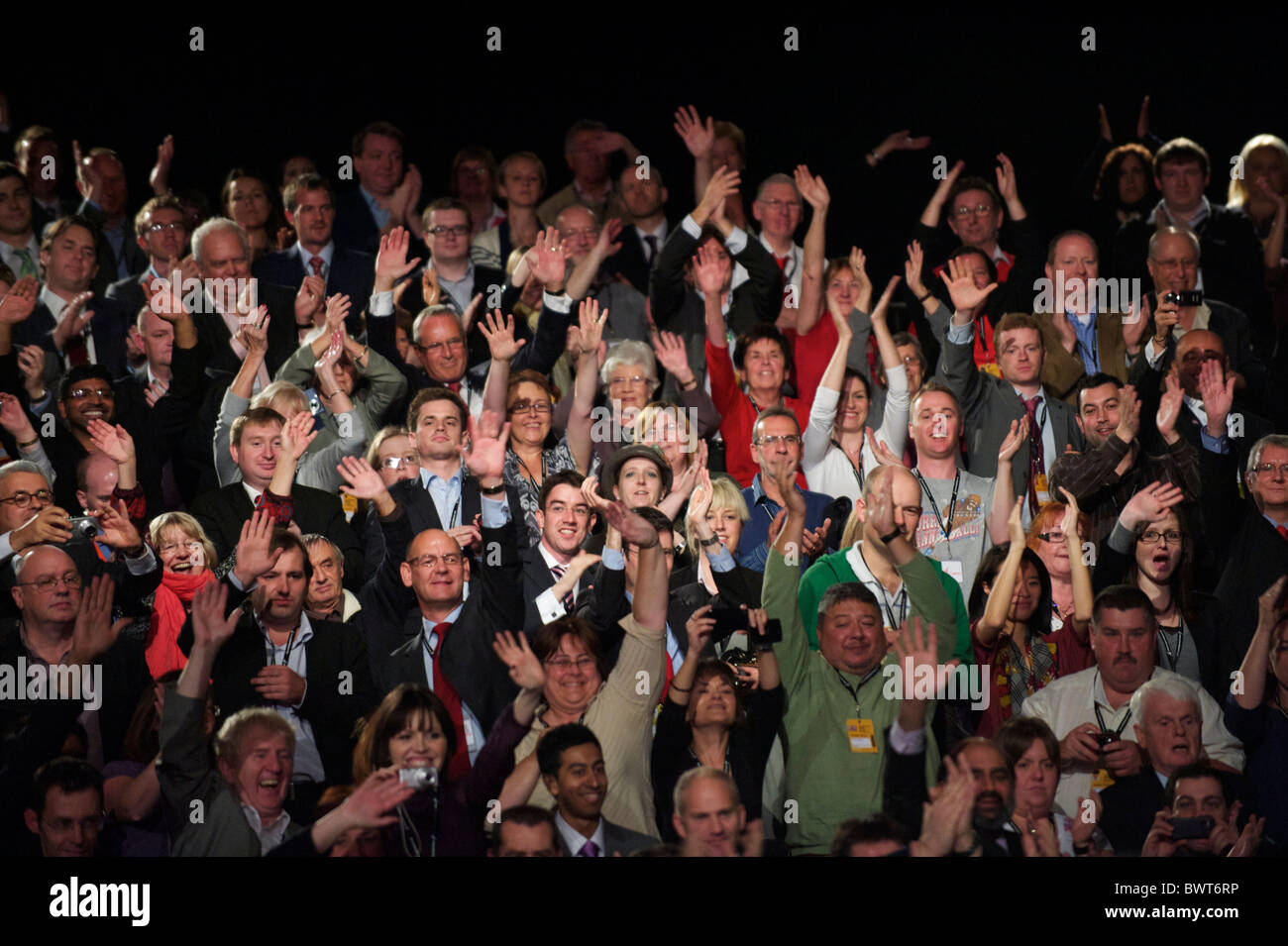 The crowd erupts as Ed Miliband circles the auditorium greeting delegates at the conclusion of his leader's - Stock Image