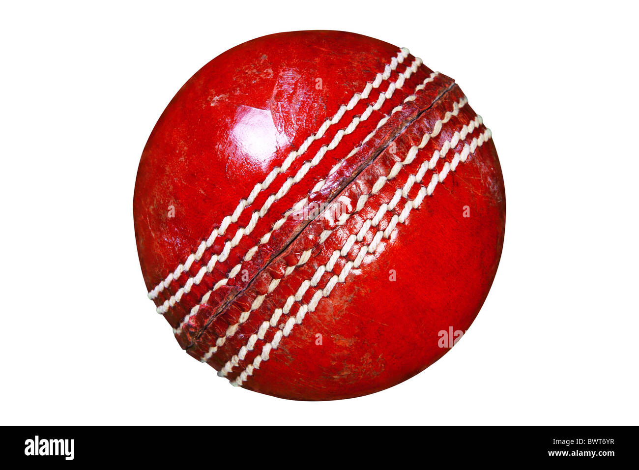 Photo of a red leather cricket ball isolated on white background with clipping path done using pen tool. Stock Photo