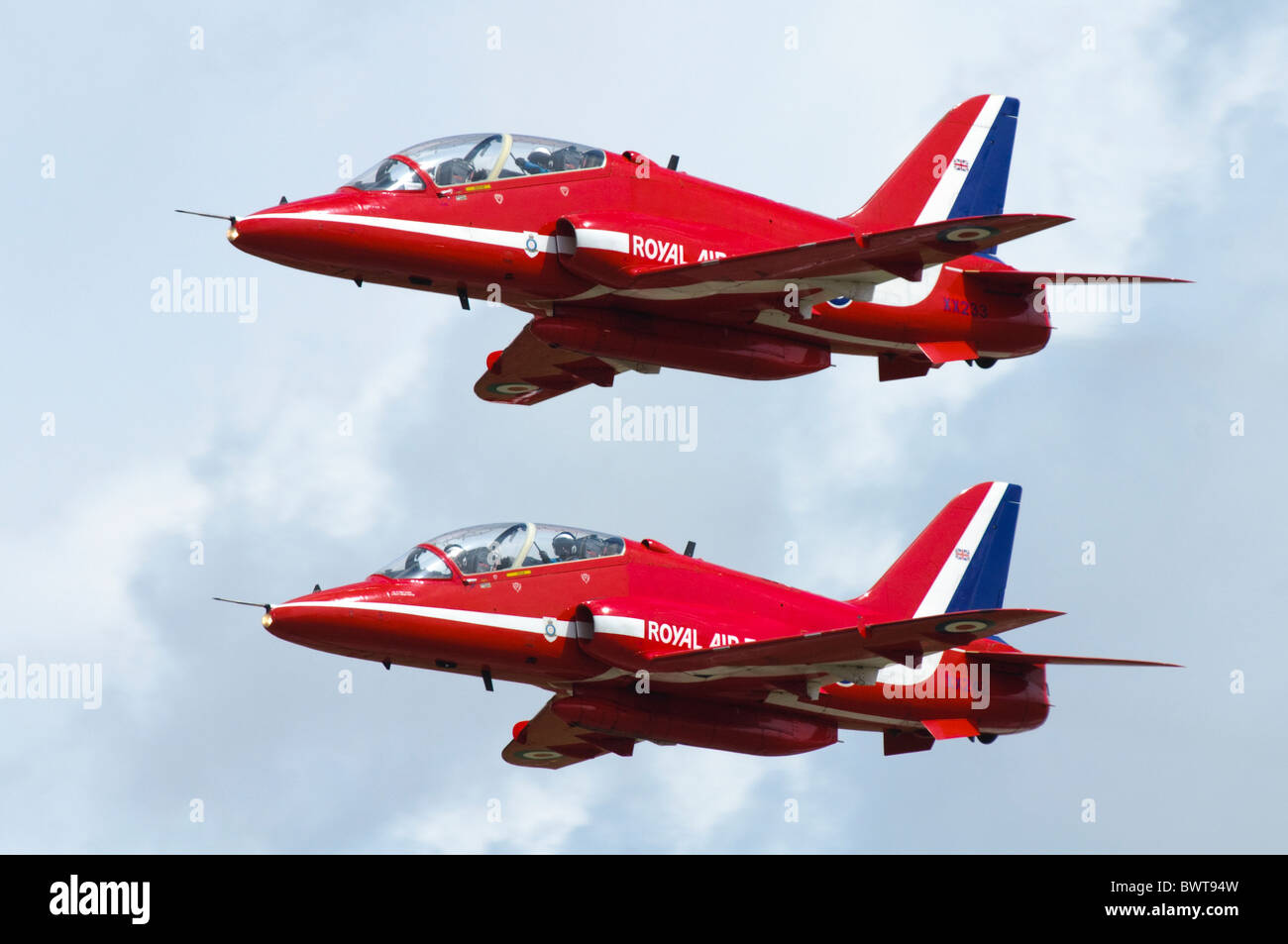 Red Arrows Hawk T1s in a two-ship formation departing RAF Fairford - Stock Image